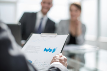 background image of a businessman checking financial documents.