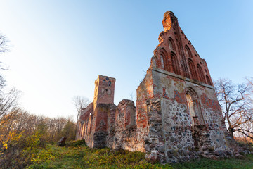 abandoned ruins of an old red brick medieval church