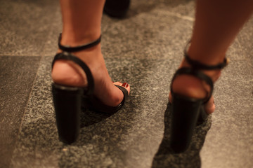 close up of woman's high heel shoes at the event