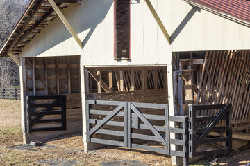 Exterior view of old open horse barn, winter, horizontal aspect
