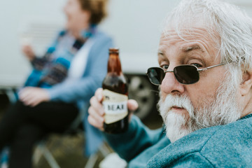 Senior man with a bottle of beer