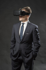 Man in black suit uses a virtual reality glasses.  VR 360. Virtual game