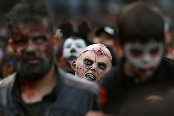 Hundreds dressed as a zombies participate in an annual Zombie Walk in Mexico City
