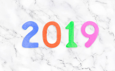 New year 2019 concept. New Year with wooden numbers 2019 against on a marble white background.