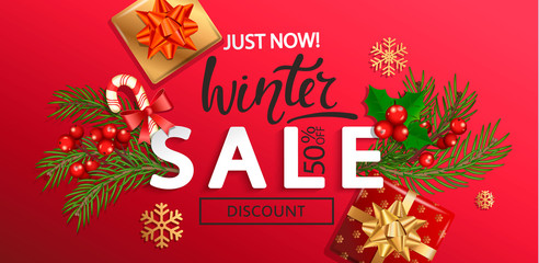 Winter sale banner for Christmas and New Year holidays.50 percent discount card on red background with traditional christmas elements-gift box with gold bow,candy cane, branch.Vector illustration.