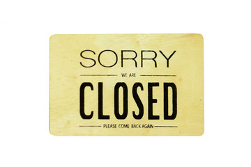 Sorry we're closed on wood hanging sign isolated on white.