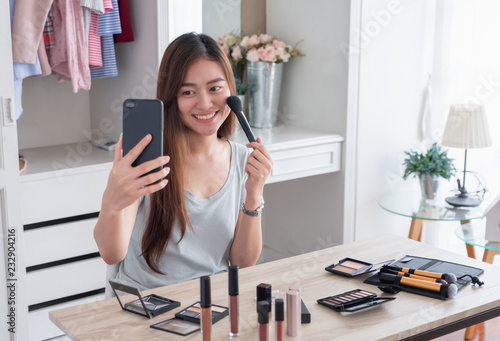 Asian Young Female Blogger Recording Vlog Video Use Mobile With