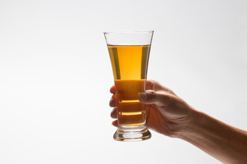 Fotobehang Bier / Cider Hand holding glass of craft beer on white background