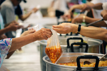 The hands of the rich give food to the hands of the poor. Concept: The concept of sharing