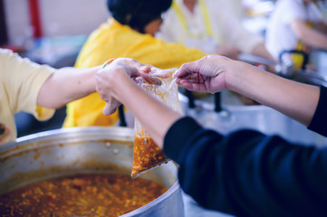 The Society of Sharing Food to Homeless and the Poorest: The Concept of Feeding