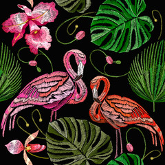 Embroidery flamingo, palm tree leaves, tropical seamless pattern. Fashionable template for design of clothes. Tropical embroidery pink flamingos, summer background