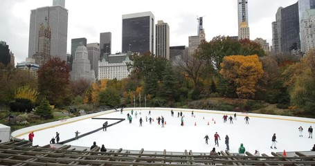 Fototapete - Central Park ice skate rink autumn foliage in New York City