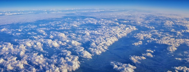 Aerial Cloudscape view over midwest states on flight over Colorado, Kansas, Missouri, Illinois, Indiana, Ohio and West Virginia during autumn. Grand sweeping views of landscape and clouds. Views of cr