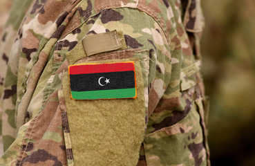 Libya flag on soldiers arm. Libyan army (collage)