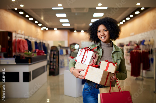 African american girl shopping gifts in mall on christmas sale. New year  holidays concept. 68148d2450d
