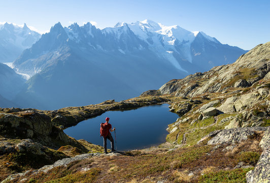 Hiker looking at Lac des Cheserys on the famour Tour du Mont Blanc near Chamonix, France.