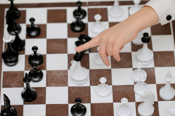 game of chess on a board, gambling game