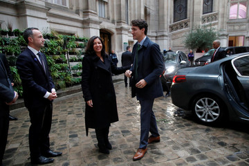 Paris Mayor Anne Hidalgo wecolmes Canadian Prime Minister Justin Trudeau as he arrives to attend the GovTech Summit at Paris city hall