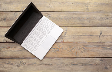 Top view of modern  laptop on wooden desk