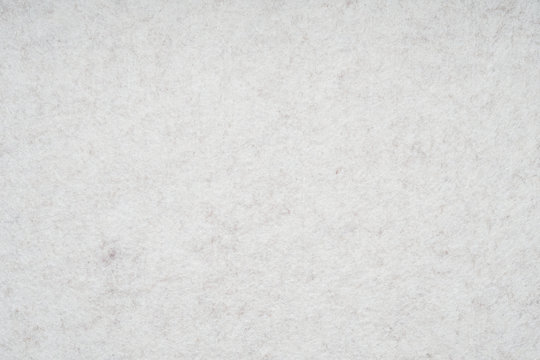 light gray or off-white felt background with fiber texture