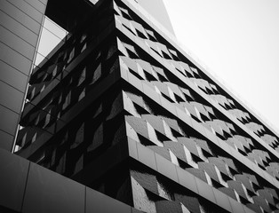 Urban Geometry, looking up to glass building. Abstract architectural design. Inspirational, artistic image