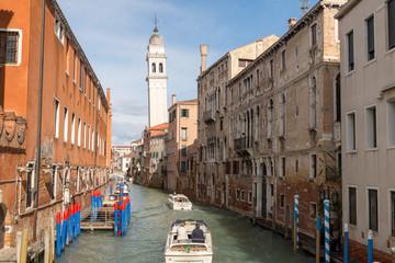 VENICE, ITALY- OCTOBER 30, 2018: Traditional narrow canal with gondolas in Venice, Italy