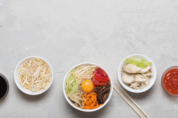 Traditional Asian Bibimbap dish with rice and vegetables