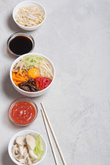 Traditional Korean Bibimbap dish with rice and vegetables on top