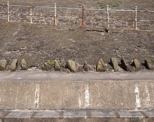 old concrete pedestrian ramps with rusting steel railings on the seawall in blackpool