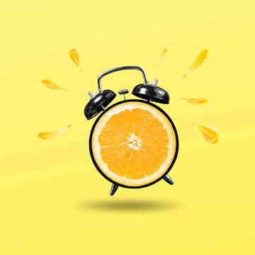 freshing time with orange clock on yellow