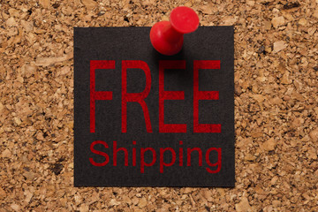 Mural message. Reminder of Black Friday. Red thumbtack. Text: Free Shipping