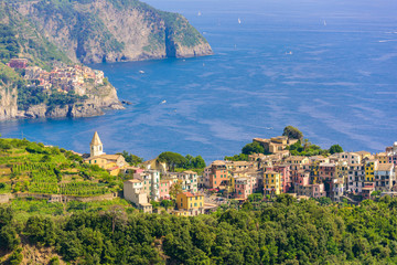 Corniglia - Village of Cinque Terre National Park at Coast of Italy. In the background you can see Manarola. Province of La Spezia, Liguria, in the north of Italy - Travel destination in Europe.