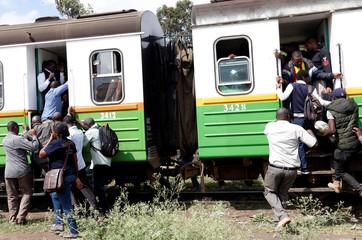 Passengers jostle to board a Nairobi Commuter Rail Service's (NCRS) commuter train at the Mutindwa station in Nairobi