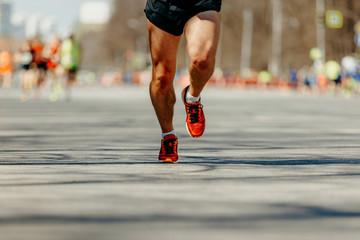 Wall Mural - feet man runner marathon race on spring city street