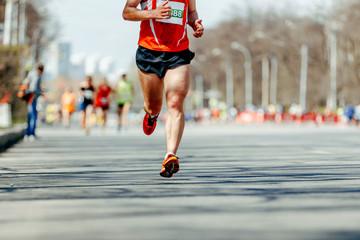 Wall Mural - leader man runner marathon race on spring city street