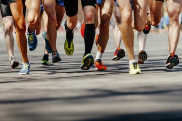 Wall Mural - legs group men runners running on asphalt road