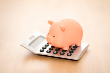 Piggy bank on calculator. Saving, accounting or banking concept.