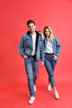 Full length portrait of a happy young couple