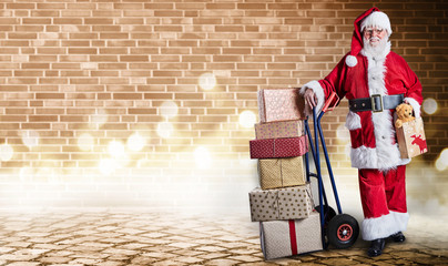 Santa with presents on trolley in festive lighting