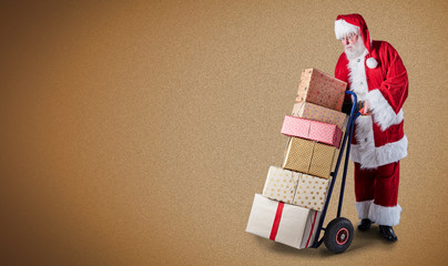 Santa with presents on trolley on plain background