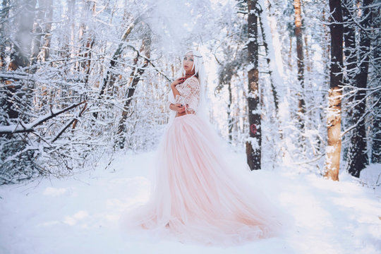 Girl elf in the winter forest in a dress