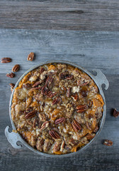 sweet potatos casserole with pecans flat lay