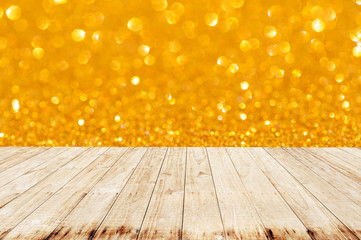 Wooden with Gold glitter lights background. defocused.