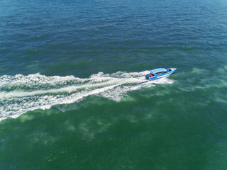 Speed boat carrying tourist on the sea for summer vocation or tourism background.
