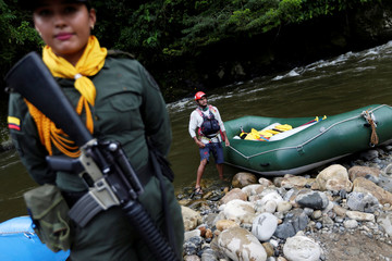A police woman escorts an inflatable raft in Miravalle