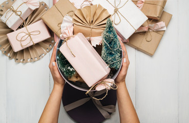 Female hand holding wrapped Christmas present