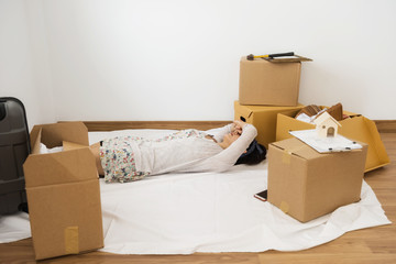 Tired woman sleep at new moving house