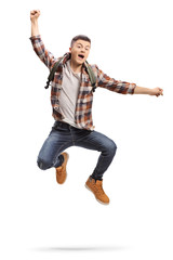 Joyful teenage student jumping