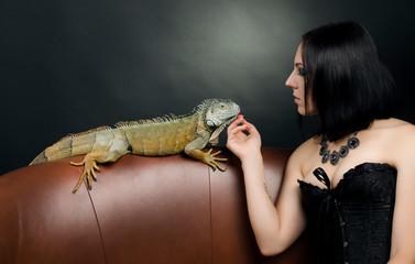 beautiful sensual woman and dragon in the studio.