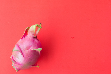 Fresh dragon fruit isolated on red background